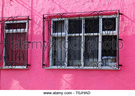 A rough rendered wall painted in shocking pink colour at Stockport UK - Stock Photo