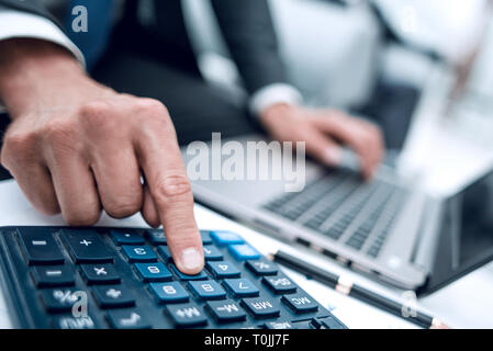 close up.businessman using a calculator for calculating financial profit. - Stock Photo
