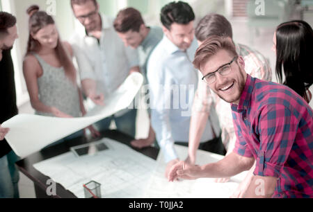young architect on the background of the design Bureau - Stock Photo