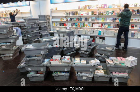 Leipzig, Germany. 20th Mar, 2019. Employees are filling the shelves of the trade fair bookstore for the Leipzig Book Fair. The Leipzig Book Fair 2019 will open in the evening with a ceremonial act. Until Sunday (24.03.2019) about 2600 exhibitors will present themselves on the exhibition grounds. At the same time the festival 'Leipzig reads' invites to numerous readings. The guest country of the Book Fair this year is the Czech Republic. Credit: Jan Woitas/dpa-Zentralbild/dpa/Alamy Live News - Stock Photo