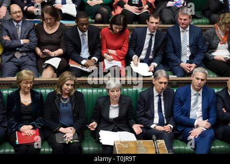 London, UK. 20th Mar, 2019. British Prime Minister Theresa May (C, Front) attends the Prime Minister's Question Time in the House of Commons in London, Britain, on March 20, 2019. Theresa May confirmed Wednesday she has written to the European Union seeking to delay Britain's departure from the bloc until June 30. Credit: UK Parliament/Jessica Taylor/Xinhua/Alamy Live News - Stock Photo