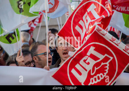 Madrid, Spain. 20th Mar, 2019. Teacher unions in Madrid protested to demand a change of the retirement law to allow workers to retire earlier in order to ensure work for the new generations. In the picture, teachers protesting with the flags of the union UGT. Credit: Lora Grigorova/Alamy Live News - Stock Photo