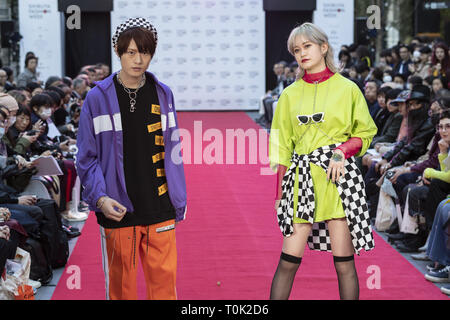 Tokyo, Japan. 21st Mar, 2019. Models wearing ''Shibuya Style'' cloth walk down a street runway for the Shibuya Runway fashion show as part of the Shibuya Fashion Week in Shibuya ward. The Shibuya Fashion Week promotes Shibuya fashion culture showcasing up and coming Japanese creators in a one-day-only fashion show, which runs in collaboration with Amazon Fashion Week TOKYO 2019 A/W Collection in Tokyo's fashionable area of Shibuya. Shibuya Fashion Week runs from March 14 to 24. Credit: Rodrigo Reyes Marin/ZUMA Wire/Alamy Live News - Stock Photo