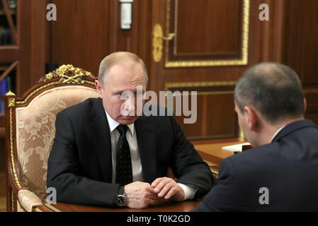 Moscow, Russia. 21st Mar, 2019. MOSCOW, RUSSIA - MARCH 21, 2019: Russia's President Vladimir Putin (L) and T Plus CEO Denis Pasler talk during a meeting at the Moscow Kremlin; President Putin has appointed Pasler Orenburg Region Acting Governor. Mikhail Klimentyev/Russian Presidential Press and Information Office/TASS Credit: ITAR-TASS News Agency/Alamy Live News - Stock Photo