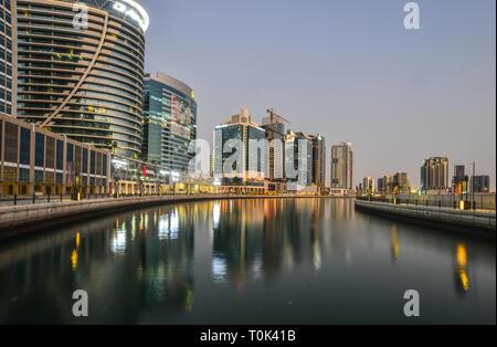 Dubai, UAE - Dec 10, 2018. Cityscape of Dubai at twilight. Dubai is a global city and business hub of the Middle East. - Stock Photo