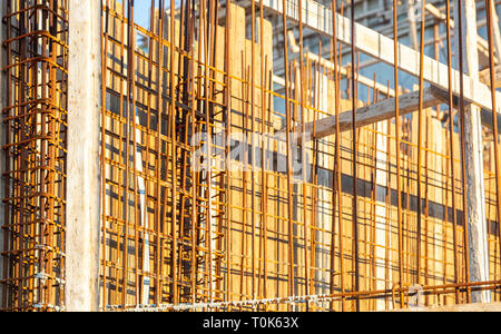 Reinforced concrete, under construction. Formworks and steel bars reinforcement in a construction site, closeup view. - Stock Photo