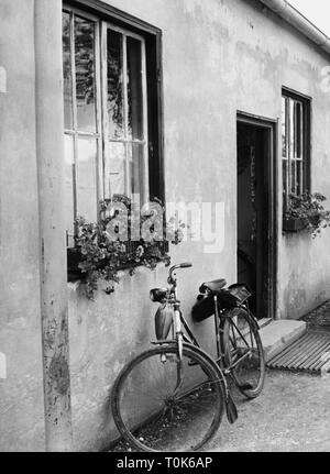 geography / travel, Germany, Dachau, concentration camp, refugee camp, bicycle on front of an appartement, 1960, Additional-Rights-Clearance-Info-Not-Available - Stock Photo