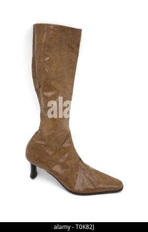 A Pair of Brown Knee High Leather High Heel Boot - Stock Photo