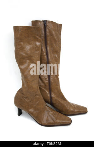 A Pair of Brown Knee High Leather High Heel Boots - Stock Photo
