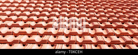 Roofing construction. Red roof ceramic tiles texture background. - Stock Photo