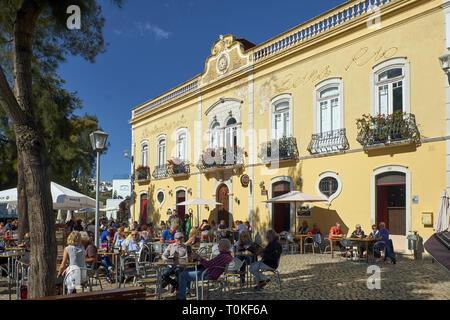 Open-air restaurant on the river Gilao in Tavira, Faro, Algarve, Portugal - Stock Photo