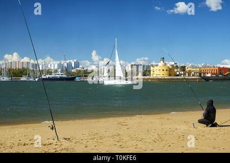 View from Ferragudo with anglers to the marina of Portimão, Ferragudo, Faro, Algarve, Portugal - Stock Photo