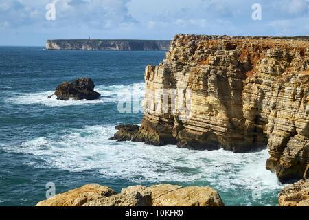 Rocky coast at Cabo de Sao Vicente with stormy sea near Sarges, Algarve, Faro, Portugal - Stock Photo
