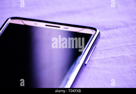 A smartphone with a power bank - Stock Photo