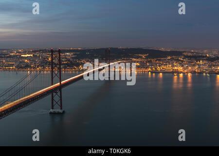 Ponte 25 de Abril in Lisbon, Cristo Rei statue, sunset, Portugal - Stock Photo