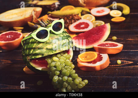 Fashion hipster watermelon fruit. Bright summer color, accessories. Tropical watermelon with sunglasses. Creative art concept. Summer party background - Stock Photo
