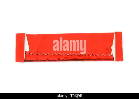 Stick of gum wrapped in red shiny wrapper isolated on white - Stock Photo