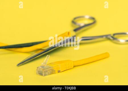 Internet censorship concept.  Internet cable cut by scissors. - Stock Photo