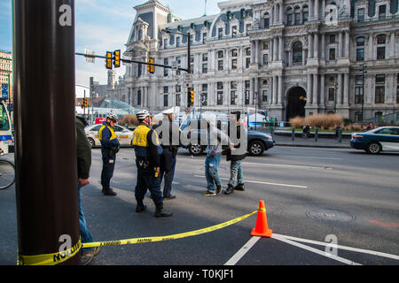 Philadelphia, Pennsylvania - February 5, 2019: Black male is seen here arguing with two Philadelphia police officers during a demonstration in front o - Stock Photo