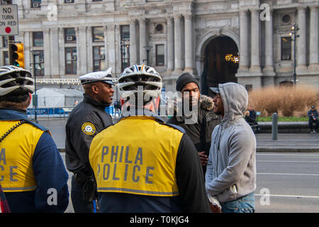 Philadelphia, Pennsylvania - February 5, 2019: Black male is seen here talking to two Philadelphia police officers during an demonstration in front of - Stock Photo