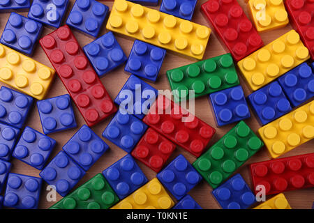 Beautiful background from a multi-colored plastic brick - Stock Photo