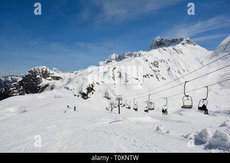 Sella Nevea, Italy - April 4th 2018. The slopes of Sella Nevea at the end of the ski season in early April, Friuli Venezia Giulia, north east Italy - Stock Photo