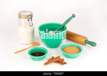 Baking Ingredients with Vintage Fiesta Ware Bowls and Antique Rolling Pin. Cinnamon, Organic Sugar, Wheat Flour in Glass Jar. Wooden Spoon. - Stock Photo