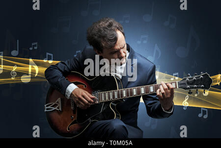 Young male musician playing on his guitar with musical notes around