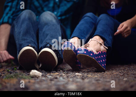 Couple's Shoes on Rocky Ground - Stock Photo
