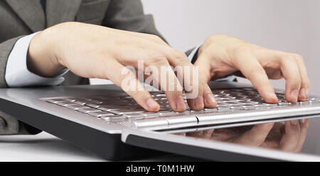 closeup. businessman typing on laptop keyboard. isolated on a white background. - Stock Photo