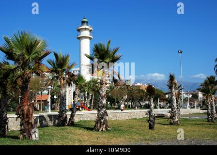 View of the lighthouse and palm trees along the promenade, Torre del Mar, Malaga Province, Andalusia, Spain, Western Europe. - Stock Photo