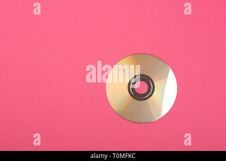 CD disk at pink background. Flat lay, top view. Copy space for your text. - Stock Photo