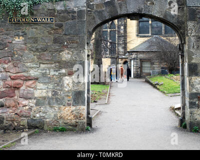 Arch through the Flodden Wall into Greyfriars Kirkyard in the Old Town in Edinburgh Scotland - Stock Photo