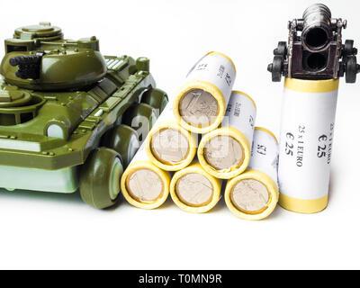 financing war concept, money with tank gun - Stock Photo