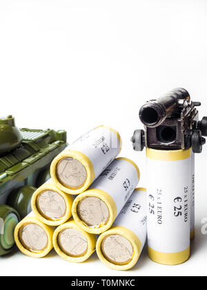 Tank gun and stack silver coins military budget concept isolated on white background. - Stock Photo