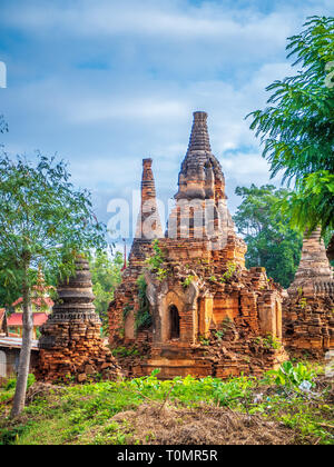 Ruined Shwe Inn Thein Pagoda Complex on Inle lake in Shan State of Myanmar - Stock Photo