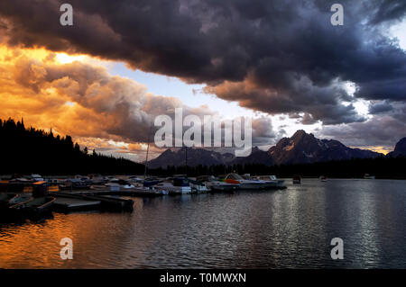 Sunset over Jackson lake with Grand Tetons in the background. - Stock Photo