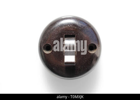 Antique switch on off bakelite 1960s, isolated on white background, close-up - Stock Photo