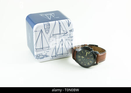 Photo of Fossil men watch isolated on a white background. Fossil Group, Inc. is an American fashion designer and manufacturer of watches. - Stock Photo