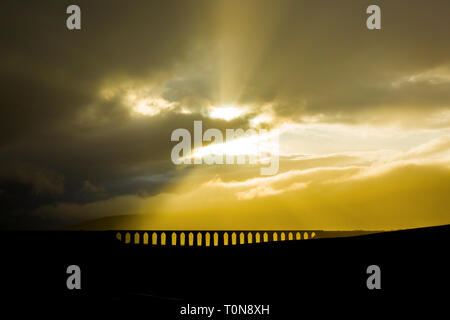 Great Britain, England, North Yorkshire.  Ribblehead Viaduct under a stormy sky. - Stock Photo