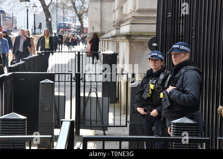 Armed Police Officers, Entrance to 10 Downing Street, London. UK - Stock Photo