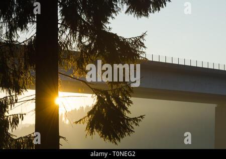 Brücke im Sonnenaufgang - Stock Photo