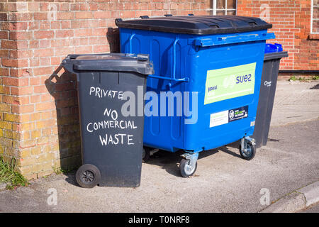 Waste recycling bins for private and business users await emptying in Devizes Wiltshire England UK - Stock Photo