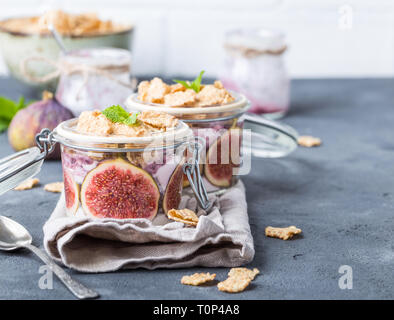 Yoghurt in jar with muesli - Stock Photo