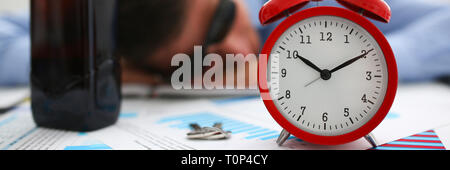 Businessman in blue shirt asleep at work on the background of a  - Stock Photo