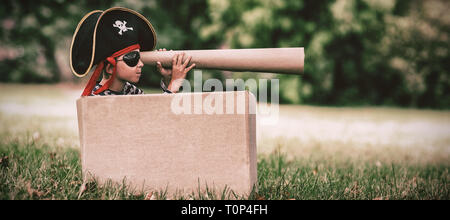 Boy pretending to be a pirate - Stock Photo
