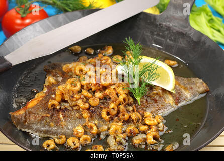 Plaice in a Pan with small Shrimps - Stock Photo