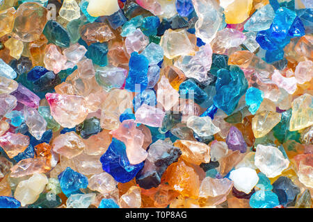 Small shiny colorful stones as a background pattern - Stock Photo