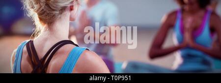 Instructor taking yoga class - Stock Photo