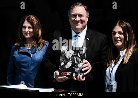 Jerusalem, Israel. 21st March, 2019. Secretary of State of the United States of America, MICHAEL MIKE POMPEO (C), visits Yad Vashem World Holocaust Remembrance Center touring the 'Flashes of Memory - Photography during the Holocaust' exhibition, partaking in a memorial ceremony in the Hall of Remembrance and signing the guest book. Pompeo's visit to Israel comes ahead of a meeting between Trump and Netanyahu planned for 25th March, 2019, in Washington, perhaps signaling the U.S. Credit: Nir Alon/Alamy Live News - Stock Photo